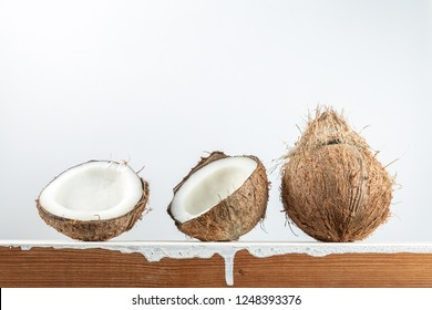 Tropical fruit whole and half abstract background .Coconut on wood table with white background.