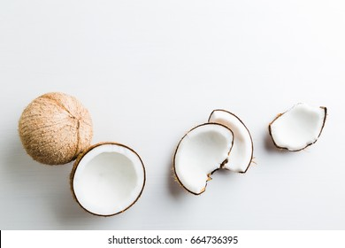 Tropical fruit whole and half abstract background .Coconut on white background. from top view