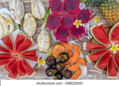 Tropical fruits assortment, close up, top view. Many colorful ripe fruits background. Durian, papaya, watermelon, banana, mangosteen, pineapple and pitahaya or dragon fruit in island Bali, Indonesia