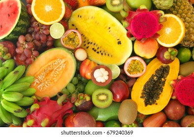 Tropical fruits background, many colorful ripe tropical fruits