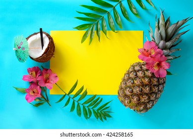 Tropical fruits background with pineapple, beach wedding invitation card or summer banner