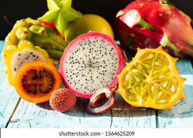 tropical fruits in blue wooden, vibrant colors