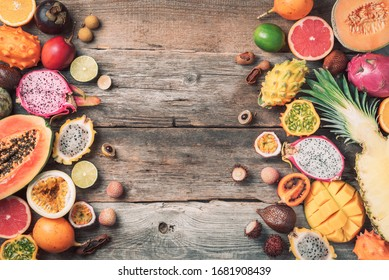 Tropical fruits concept. Exotic fruits - pineapple, papaya, mango, annona, banana, pitahaya, kiwano, african horned melon, tamarillo fruit, granadilla, salak, snake fruit, maracuya, rambutan, lychee