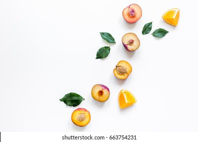 tropical fruits design with orange and peach on white table background top view mock up