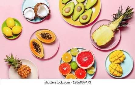 Tropical fruits minimal table setting, view from above
