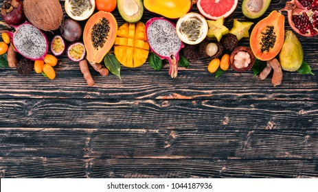 Tropical fruits On a wooden background.