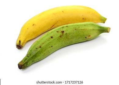 Tropical fruits, plantains on white table, isolated.