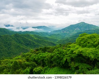 Tropical Green Mountains with clouds and sky