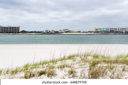 Tropical Gulf coast beach town of Orange Beach, Alabama.  White sandy beach dunes with inlet bay water and scenic city tourist destinations.  Beautiful scenic tourist travel destination location.