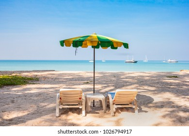 Tropical holiday concept - beautiful sandy beach with umbrella and sun beds on the beach, a holiday escape at Layan Beach, Phuket, Thailand.