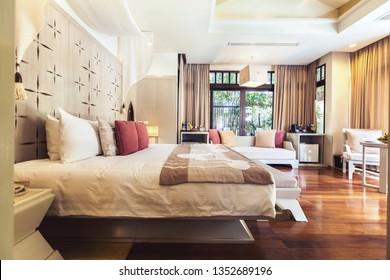 Tropical hotel room interior. Big windows, sunny space