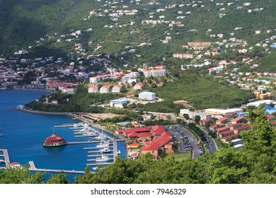 Tropical houses on hill overlooking harbor. St John US Virgin Islands