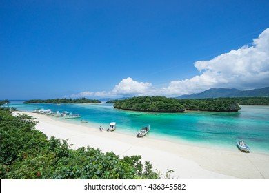 Tropical island beach with clear blue lagoon water, Okinawa, Japan