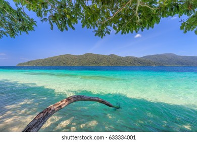 Tropical island beach and clear blue lagoon water with blue sky at Lipe Island, Satun Province, South of Thailand