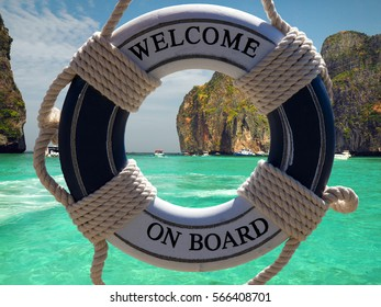 tropical island behind the boat safe belt with welcome sign.Photo is made on Maya beach Phi phi island,Thailand