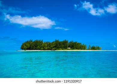 Tropical island with blue sky and white clouds