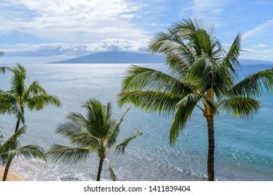 Tropical Island - A bright sunny day at north-west coast of Maui island, with Lanai island at horizon. Maui, Hawaii, USA.