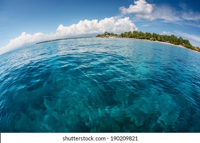 Tropical island and calm turquoise sea at sunny day, Gili Trawangan, Indonesia