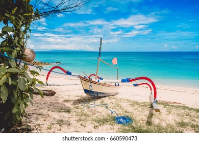 Tropical island in Indonesia, blue ocean and boat on beach