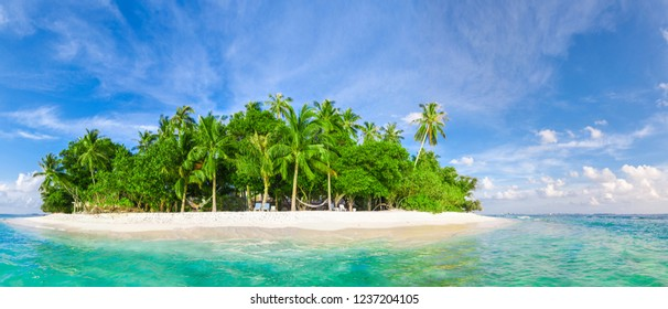 Tropical island with palm trees in the turquoise lagoon