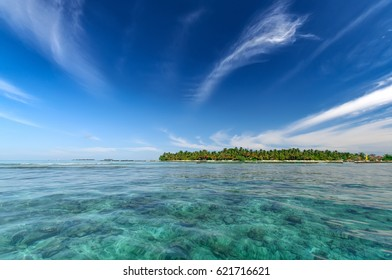 Tropical island resort seascape at sunny day with blue sky