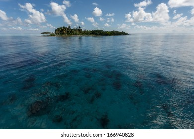 Tropical island rises a little above the coral reef in Hol Chan Marine Reserve, Belize