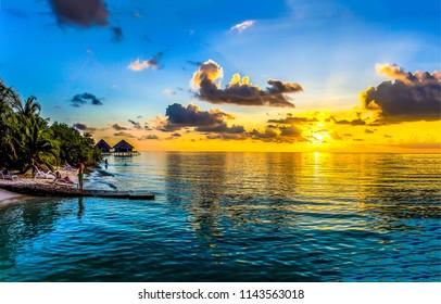 Tropical island sunset beach landscape. Sunset tropical beach resort scene. Sunset horizon sea beach resort panorama