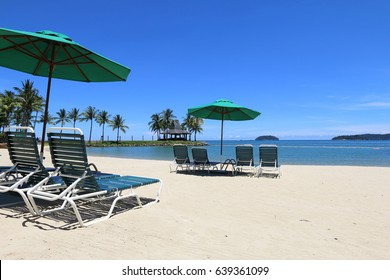 Tropical island vacation with deck chairs on beach