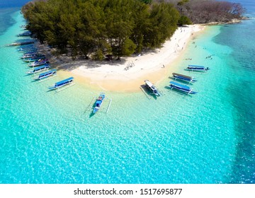 Tropical Island. View of nice tropical empty sandy beach with boats, turquoise water in Gili Nanggu Lombok Indonesia