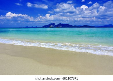 tropical  island with white sand in the sunny day with white cloud  and blue sky