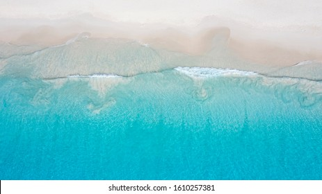 Tropical islands and beaches. Shooting from the drone. Pure turquoise waters of the ocean. White coral sand and blue lagoons.