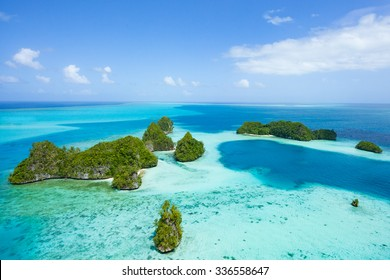 Tropical islands and clear blue water from above, Palau, Micronesia