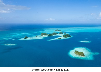 Tropical islands, coral reefs and clear blue water from above by helicopter, Palau, Micronesia