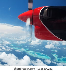 Tropical islands, view from hydroplane. Clouds in the blue sky, flight under islands in the ocean