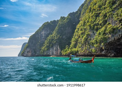 Tropical islands view with long tail boat and ocean blue sea water at Phi Phi Islands, Krabi Thailand nature landscape
