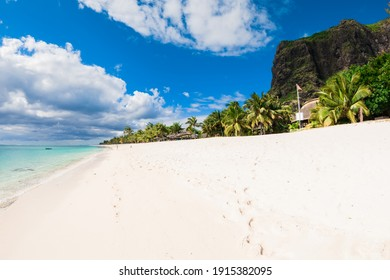 Tropical landscape - luxury beach with ocean, mountain and sky of Mauritius island, Le Morne