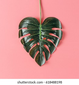 Tropical leaf in shape of a heart. Mothers day love concept. Flat lay.