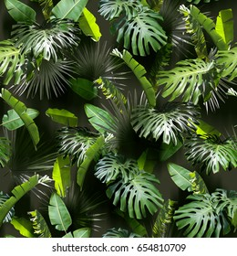 Tropical leaves pattern. Green leaf exotic plants seamless on a dark jungle background. Artistic photo collage for floral print. Natural leaves palm, banana, monstera template backdrop.