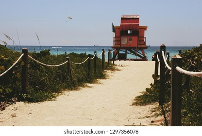 Tropical life guard house at miami beach florida hot summer day blue sky and warm sand in travel paradise holyday vacation