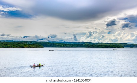 Tropical ocean landscape at early morning, canoe with fishermens, Papua new Guinea near Rabaul, wide format