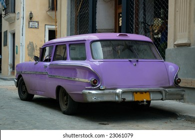 Tropical oldtimer parked in the streets of Havana