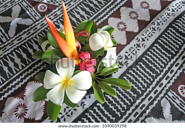 Tropical pacific islands flowers bokeh on a restaurant table in a resort in Fiji. Copy space