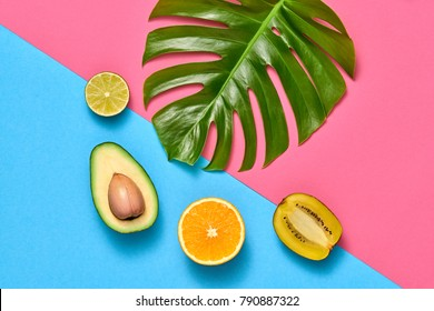 Tropical Palm Leaf and Fresh Fruits. Colorful Summer Trendy Design Set. Fashion concept. Creative Bright background. Minimal art