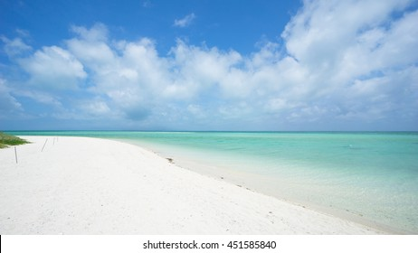 Tropical paradise beach with clear turquoise water and white sand, Okinawa, Japan