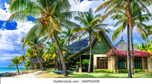 Tropical paradise - exotic luxury vacation in Mauritius island, bungalows on the beach