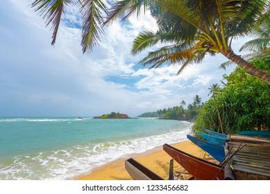 A tropical paradise idyllic beach on Sri Lanka's south coast at Mirissa.