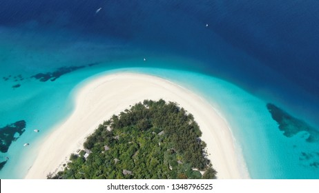 Tropical paradise Mnemba Island, located 3 km off the coast of Zanzibar's main island Unguja. This barefoot luxury island forms part of Mnemba Atoll and is a protected area for endangered sea turtles