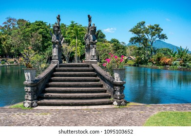 Tropical park around the pond in Tirta Gangga complex, Bali, Indonesia