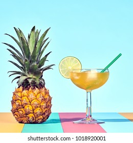 Tropical Pineapple with Cocktail on Beach. Bright Color. Hot Summer Vibes. Trendy fashion Style. Creative Art. Fun party Mood. Minimal