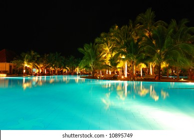 Tropical pool in luxury hotel at night
